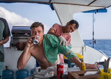 Toms life at 25 has him drinking a bintang and getting stitched up by the boats chef