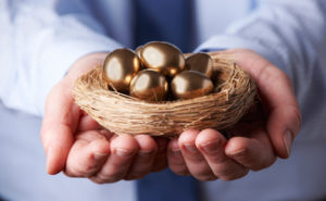 Golden nest egg in hands